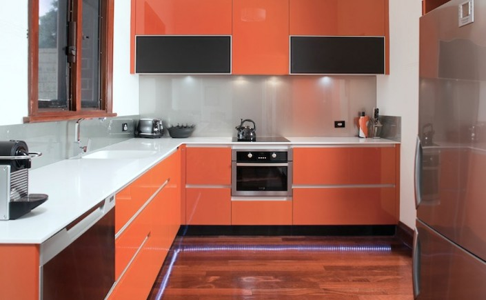 Stylish orange kitchen cabinets by Eco Cabinets in Perth